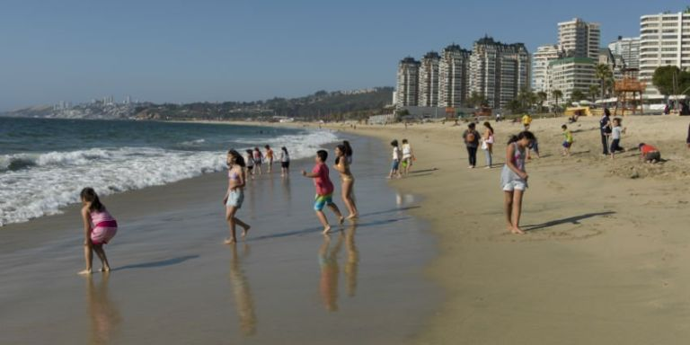 Tourists enjoying the city beach in Vina Del Mar